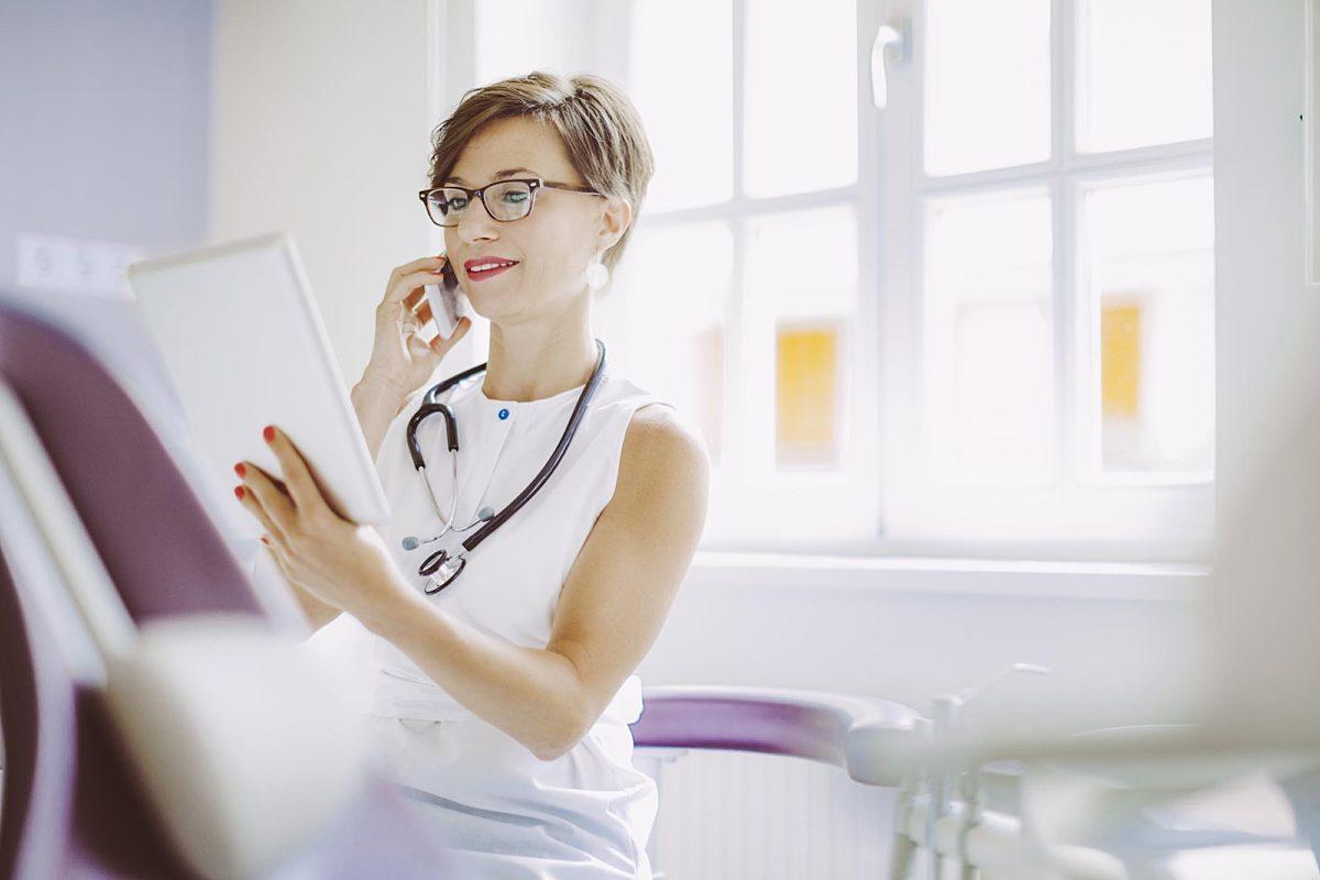 Doctor on phone WEB RGB